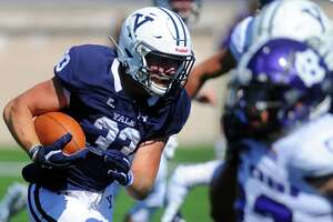 Yale's Zane Dudek, seen carrying the ball against Holy Cross on Sept. 21, 2019, is a Barstool Athlete.
