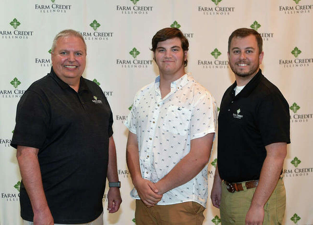 Pictured from left are Aaron Johnson, Farm Credit Illinois President/CEO; Patrick Wiemers, scholarship recipient; and Michael Kennedy, FCI Highland office representative.