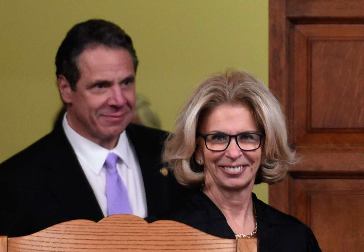 Judge Janet DiFiore enters the Court of Appeals chamber followed by Governor Andrew Cuomo before she was sworn in as the new Chief Judge of the New York State Court of Appeals Monday Feb. 8, 2016, in Albany, N.Y. (Skip Dickstein/Times Union)