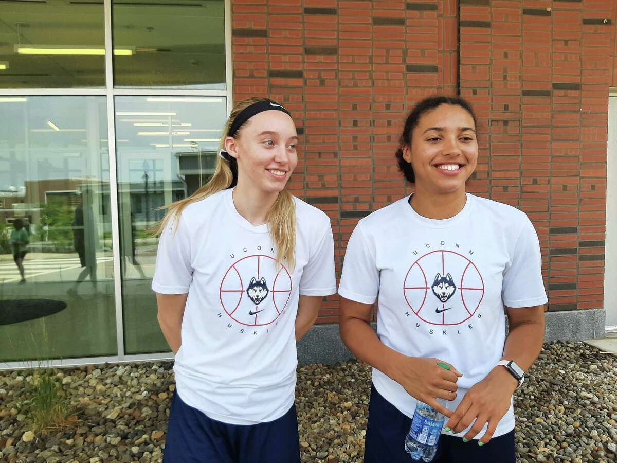 UConn sophomore Paige Bueckers, left, and freshman Azzi Fudd meet with media outside the Werth Champions Center on Tuesday in Storrs.