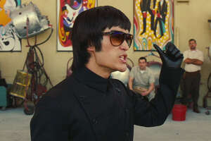 """Mike Moh as Bruce Lee in Quinetin Tarantino's """"Once Upon a Time in Hollywood."""""""