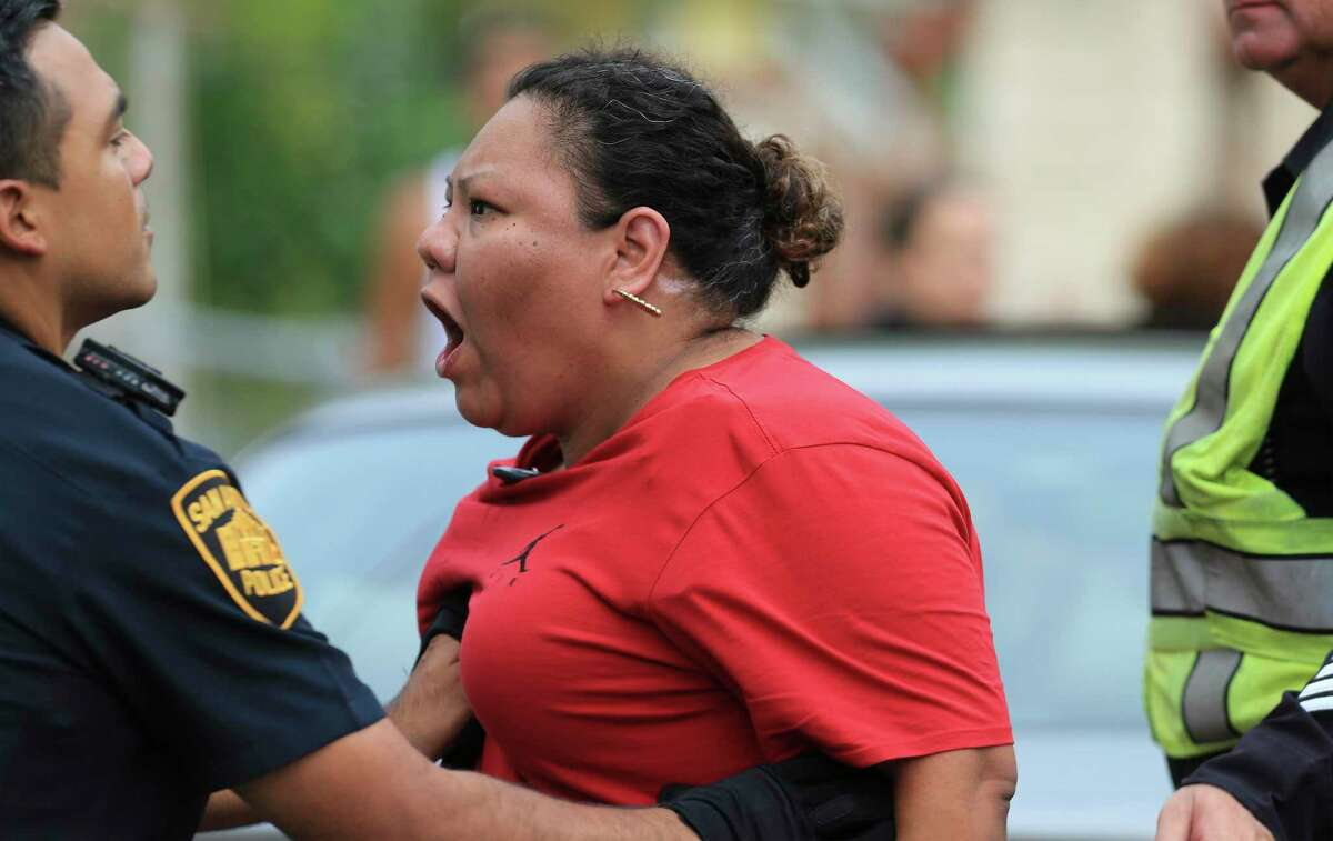 Tempers flare amongst family members after police were involved in a standoff with a man who fired shots at residents and at a KSAT television crew who were on the scene to follow up on an overnight fire incident on Monday, July 5, 2021. The man fled from the scene at the 200 block of Noria and police then surrounded him at another home on the 300 block of Noria. The suspect was killed during a shootout with five police officers during the standoff.