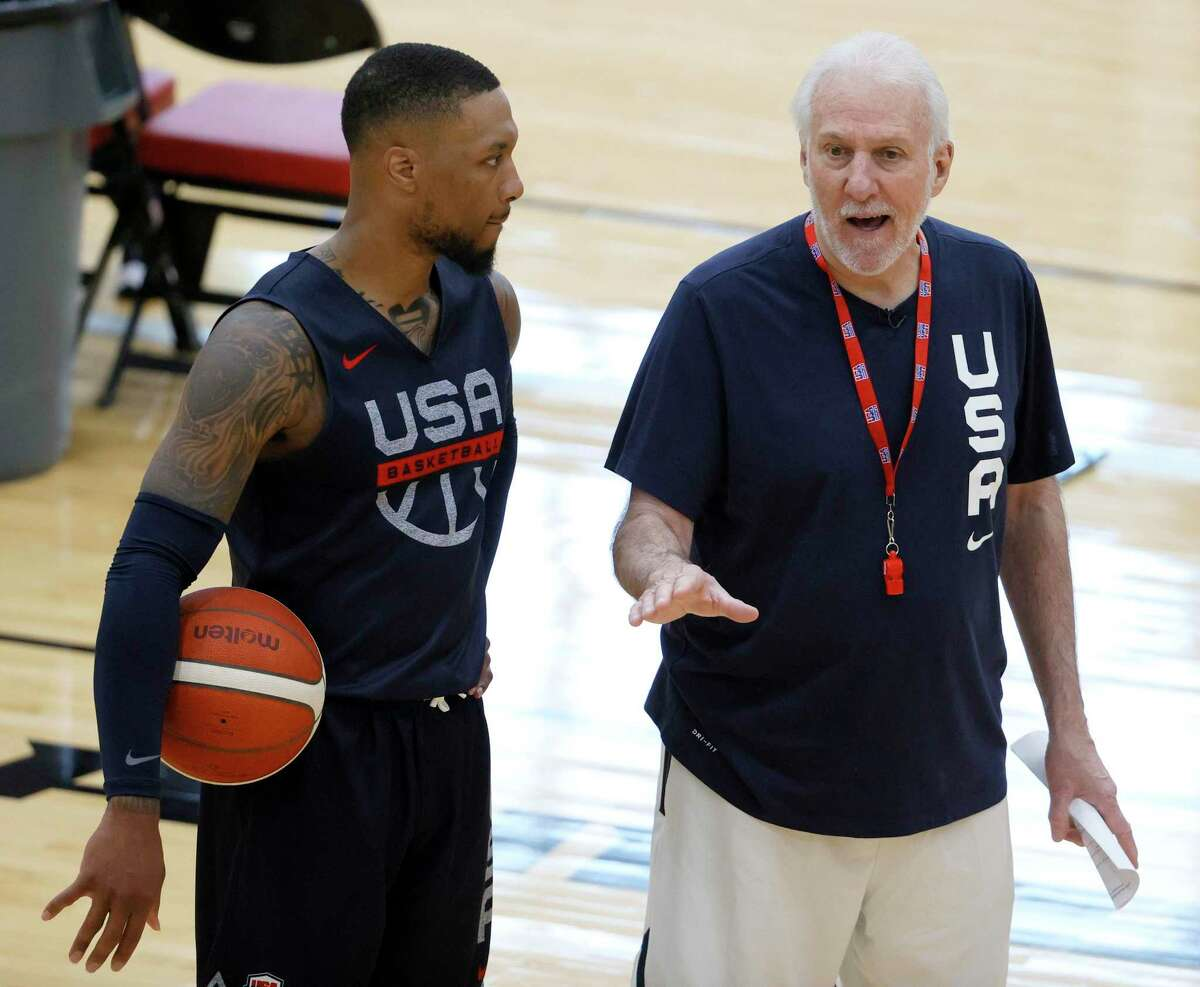 Coach Gregg Popovich instructs Damian Lillard during Team USA's first training camp workout Tuesday in Las Vegas.