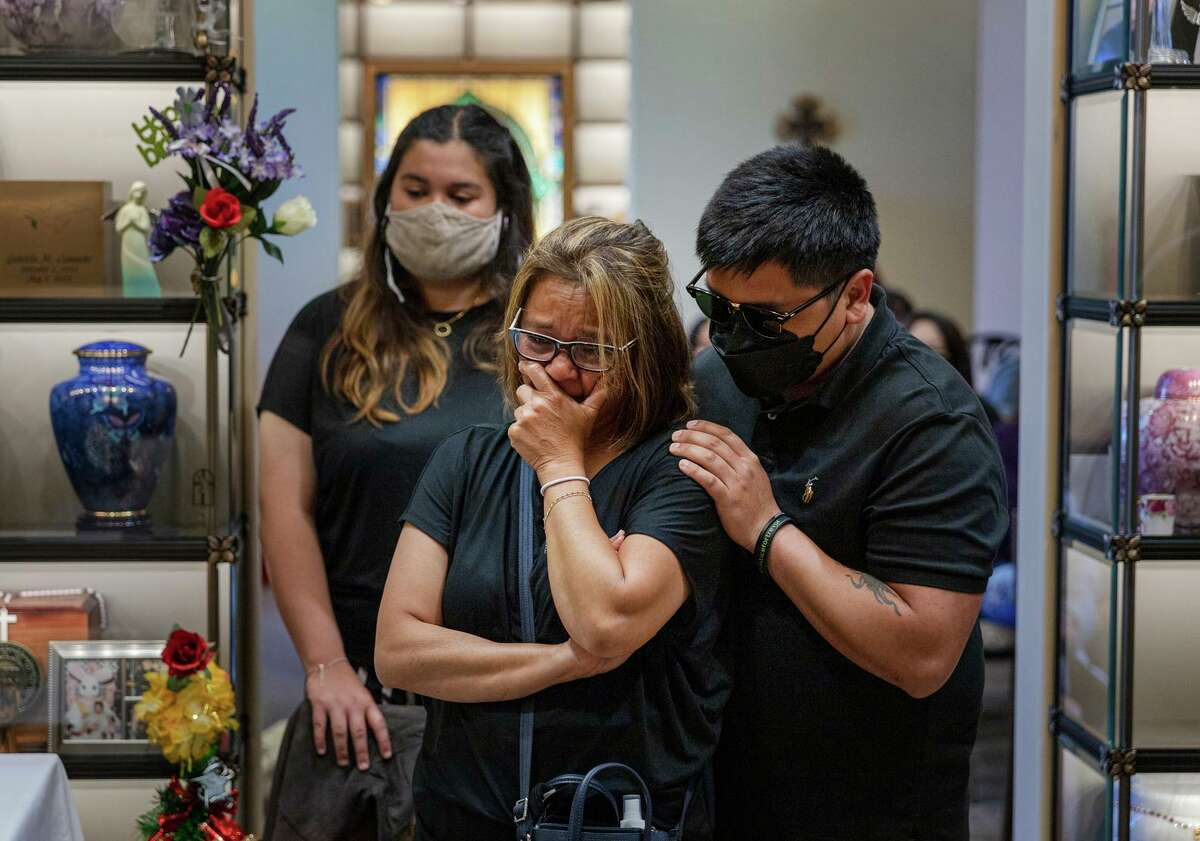 Relatives of Angelo Quinto mourn at Holy Cross Cemetery and Funeral Center in Antioch.