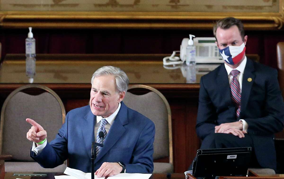 Texas Governor Greg Abbott delivers a speech while newly elected Speaker of the House, Dade Phelan joins him during the convening of the 87th Texas Legislature in Austin on Tuesday, Jan. 12, 2021.
