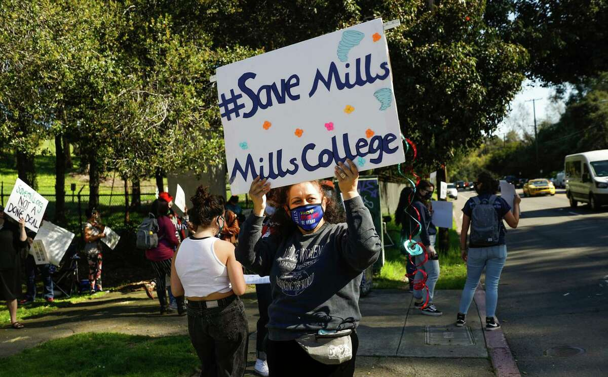 In March, Priya Kanuga and others rally at the front gate of Mills College in Oakland.