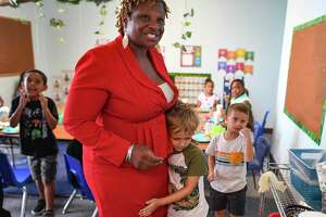 Raphaela Bailey visits with children at Bailey's Child Development Center on the Northeast Side on Thursday, July 1, 2021.