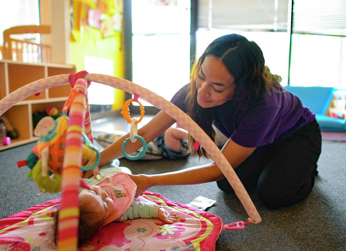 Erika Esquivel watches over infants at Bailey's Child Development Center on Thursday, July 1, 2021.