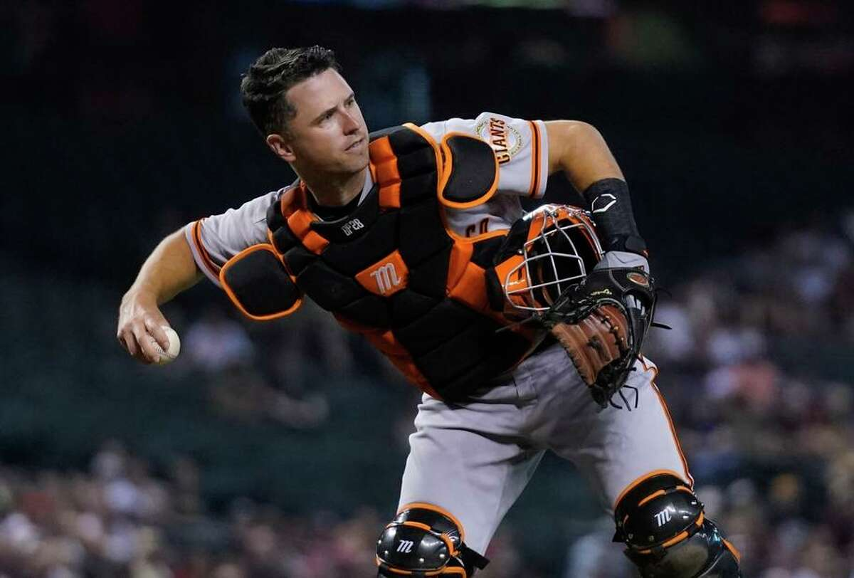 San Francisco Giants catcher Buster Posey throws the ball to first base during the second inning of a baseball game against the Arizona Diamondbacks Thursday, July 1, 2021, in Phoenix. (AP Photo/Ross D. Franklin)