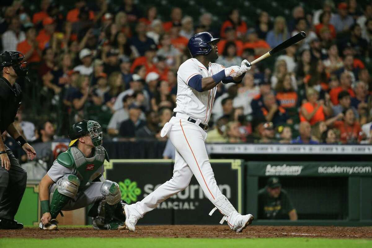Houston Astros left fielder Yordan Alvarez (44) hits a three-run home run to left field against the Oakland Athletics during the fifth inning of an MLB game at Minute Maid Park on Tuesday, July 6, 2021, in Houston.