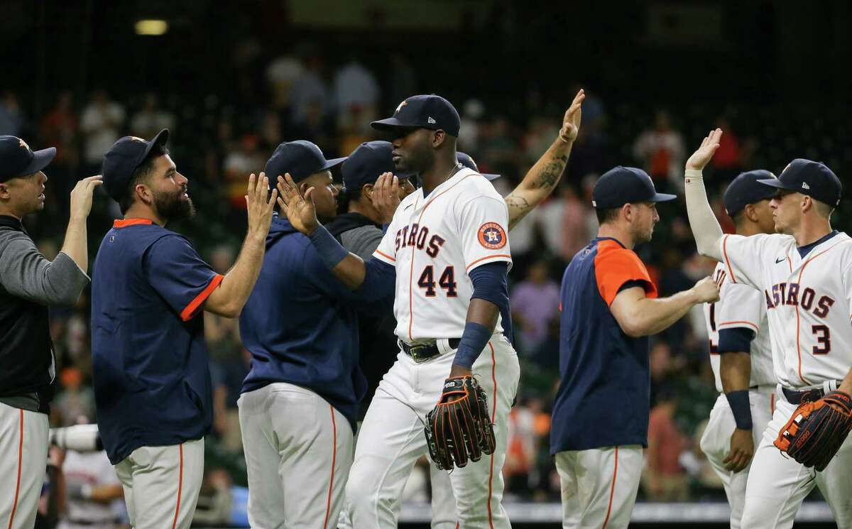 Houston Astros left fielder Yordan Alvarez (44) celebrates with teammates after defeating the Oakland Athletics 9-6 at Minute Maid Park on Tuesday, July 6, 2021, in Houston.