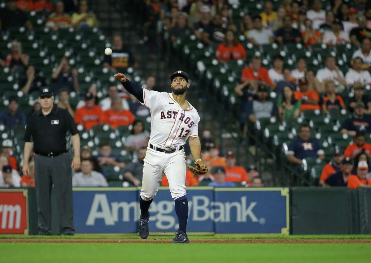 Houston Astros third baseman Abraham Toro (13) throws to first base for the first out of the 9th inning of an MLB game against the Oakland Athletics at Minute Maid Park on Tuesday, July 6, 2021, in Houston.