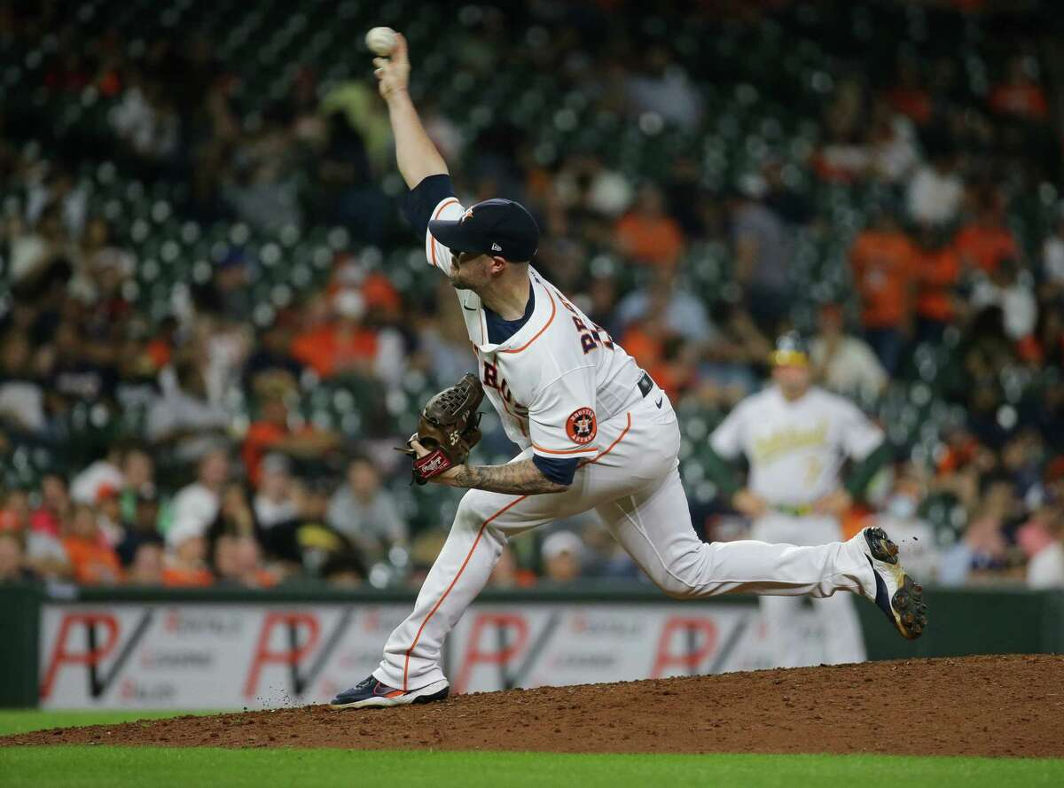 Houston Astros relief pitcher Ryan Pressly (55) throws the ball against the Oakland Athletics during the 9th inning of an MLB game at Minute Maid Park on Tuesday, July 6, 2021, in Houston.