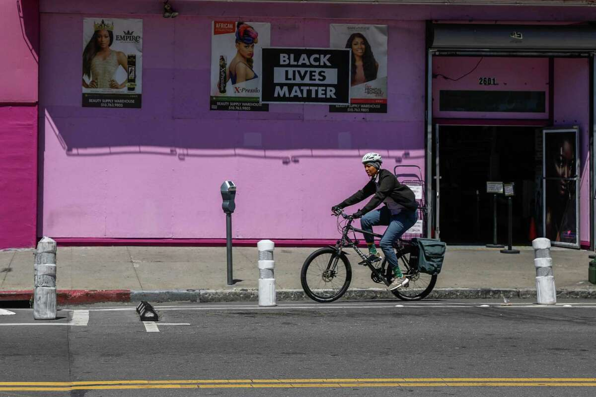 A cyclist rides in the bike lane on Telegraph Avenue on Wednesday, June 9, 2021 in Oakland, California.The Oakland Department of Transportation wants the city council to remove protected bike lanes on a nine-block downtown corridor on Telegraph Avenue later this year after installing them in 2016. The Oakland Department of Transportation director says the protected lanes from 20th to 29th Streets simply are not working.