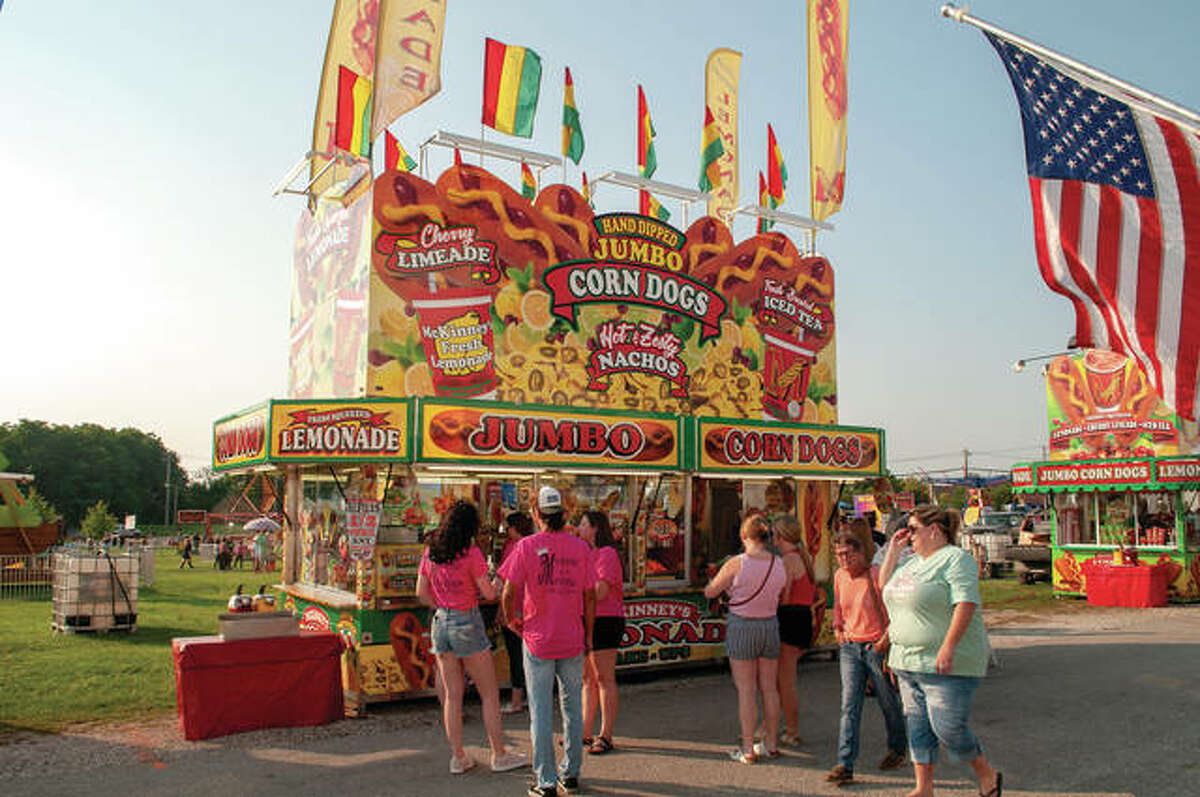 Opening day of the Morgan County Fair had people lined up for food before filling the grandstand during the queen pageant Tuesday evening.
