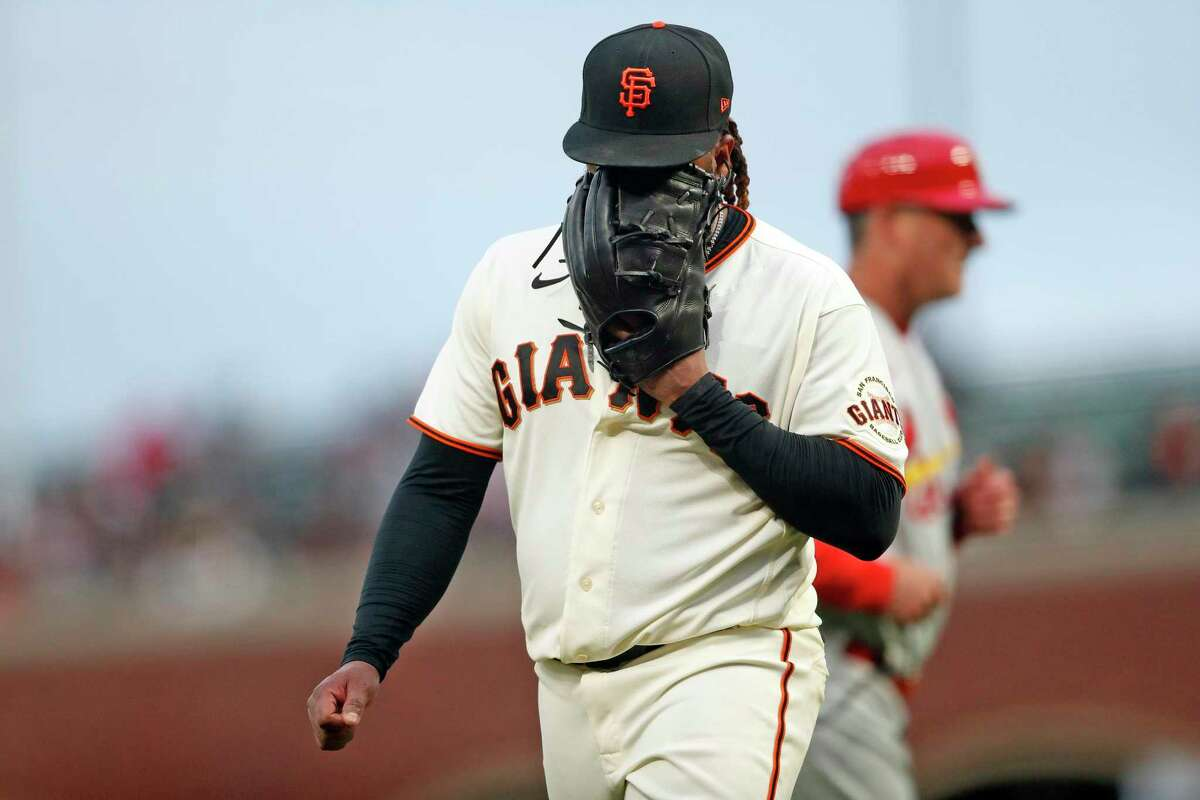 San Francisco Giants' Johnny Cueto yells into his glove after top of 4th inning where St. Louis Cardinals' Paul Goldschmidt hit a 2-run single during MLB game at Oracle Park in San Francisco, Calif., on Tuesday, July 6, 2021.
