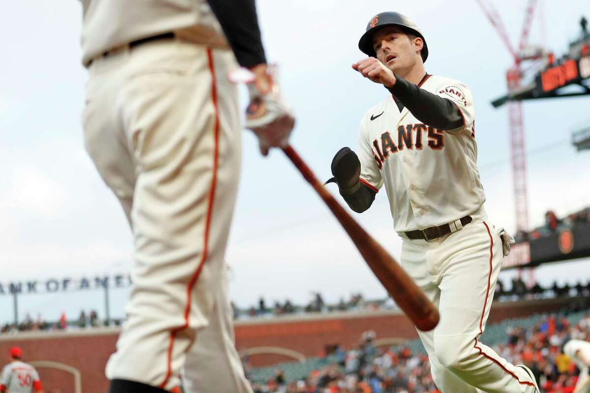 San Francisco Giants' Mike Yastrzemski fist bumps Stephen Duggar after scoring on Brandon Crawford's 2-run single in 3rd inning against St. Louis Cardinals during MLB game at Oracle Park in San Francisco, Calif., on Tuesday, July 6, 2021.