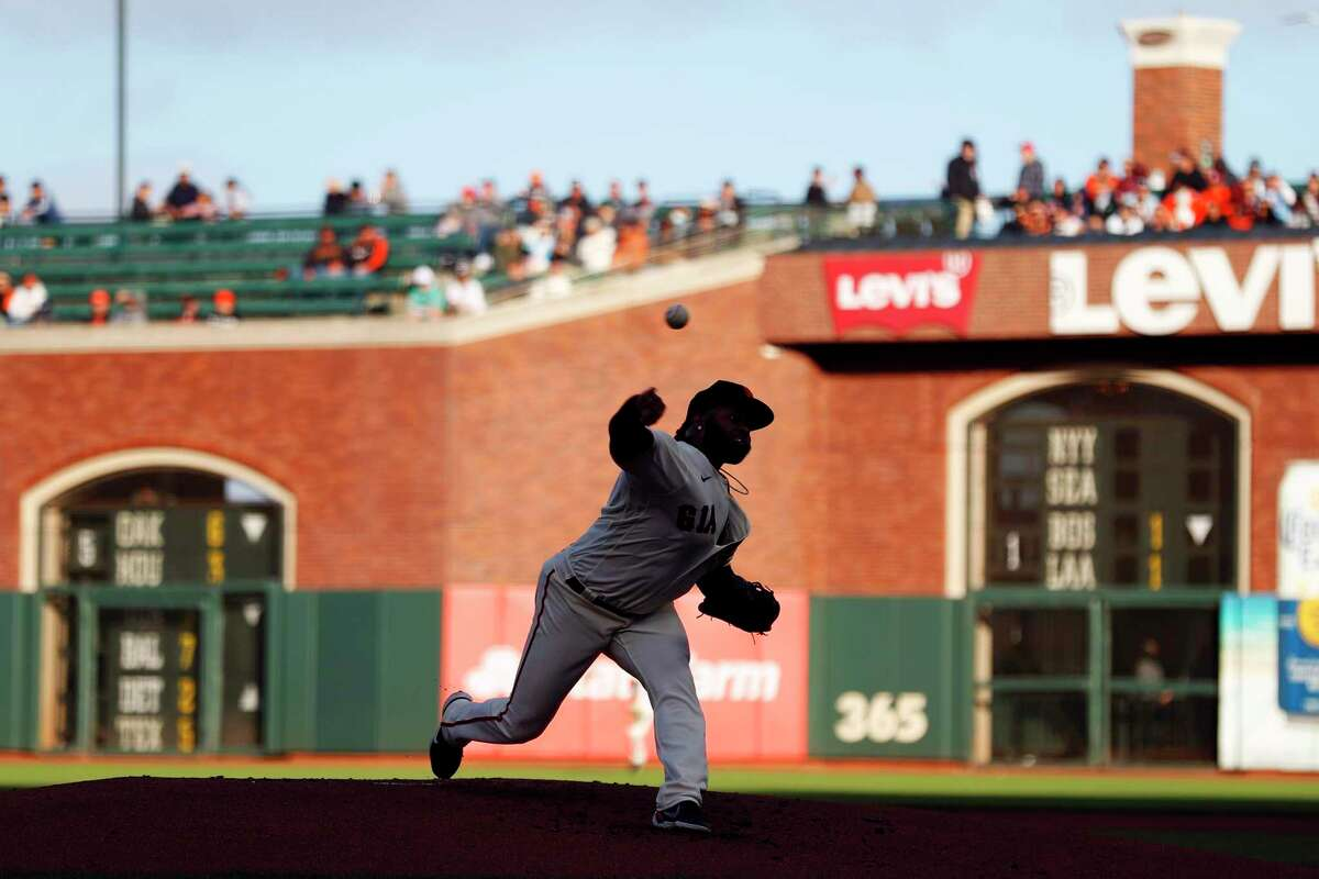 San Francisco Giants' Johnny Cueto pitches in 1st inning against St. Louis Cardinals during MLB game at Oracle Park in San Francisco, Calif., on Tuesday, July 6, 2021.
