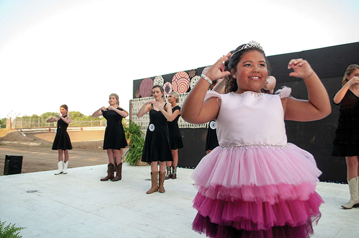 The Morgan County Fairgrounds welcomed cheers and applaud Tuesday during the Morgan County Fair Pageant.