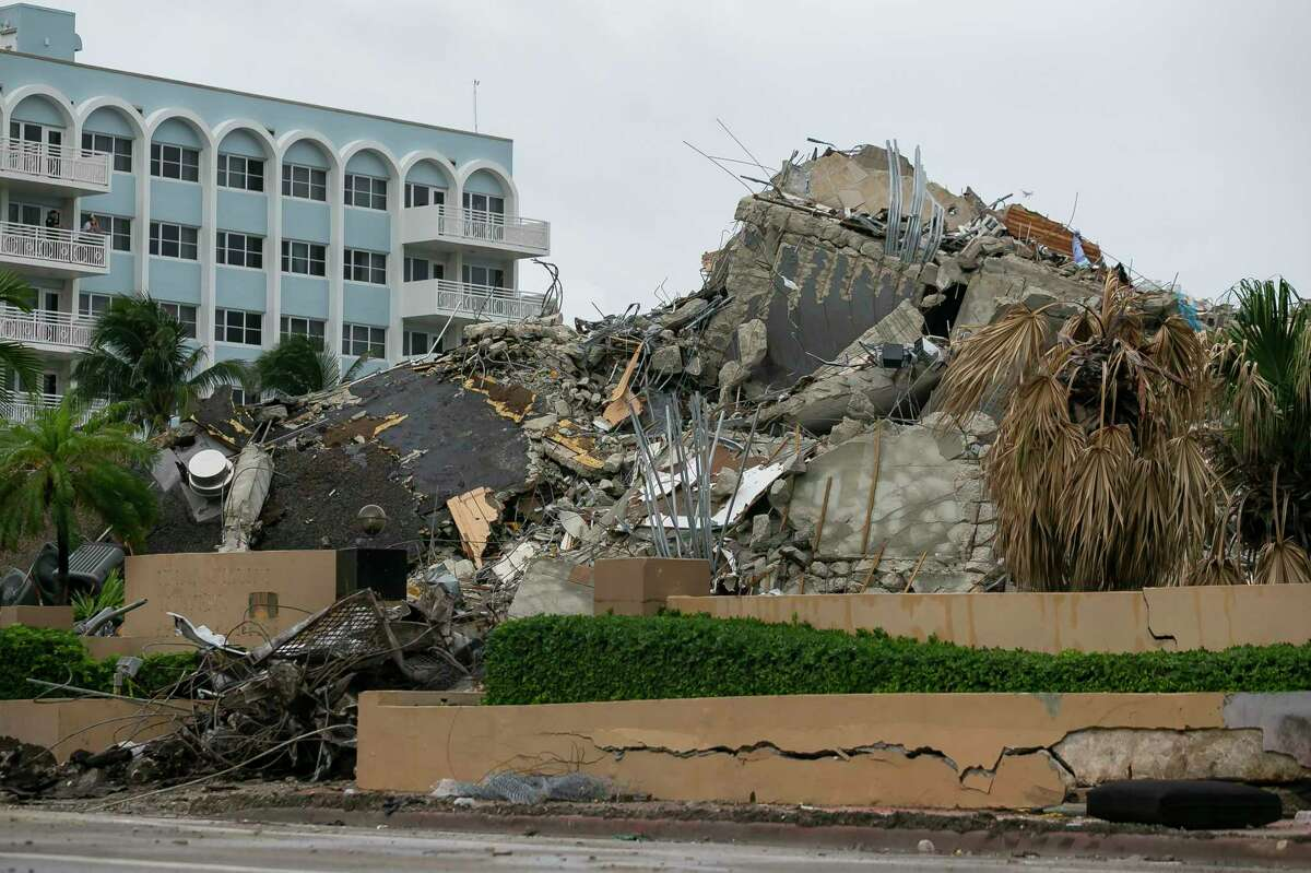 Rubble and debris of the Champlain Towers South condo can be seen Tuesday, July 6, 2021 in Surfside, Fla. Officials overseeing the search at the site of the Florida condominium collapse seem increasingly somber about the prospects for finding anyone alive. They said Tuesday that crews have detected no new signs of life in the rubble nearly two weeks after the disaster struck at the Champlain Towers South building in Surfside. (Carl Juste/Miami Herald via AP)