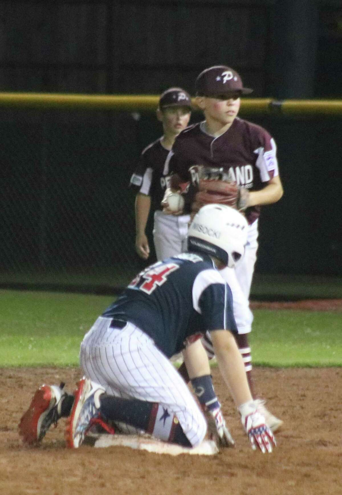 NASA 12s clean-up hitter Jackson Wisocki finds himself on second base after belting a two-RBI single to right field and going to second on a belated throw home in the fuirst inning. But it would be the team's next-to-last hit of the night in their Section 3 opener.