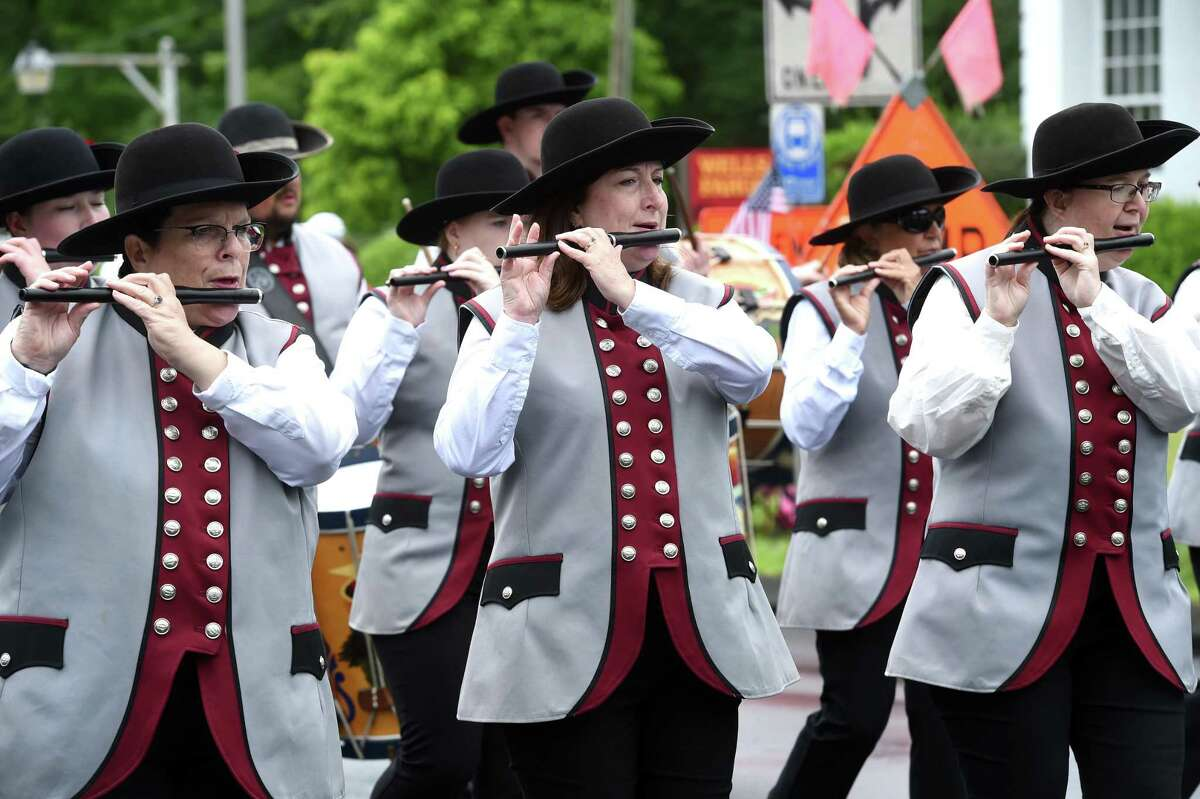 The Connecticut Patriots Fife & Drum Corps march in the Independence Day Parade in Madison on July 4.