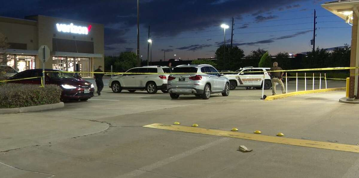 Detectives investigate a non-fatal shooting on Tuesday night in a parking lot on Fry Road in Fort Bend County.