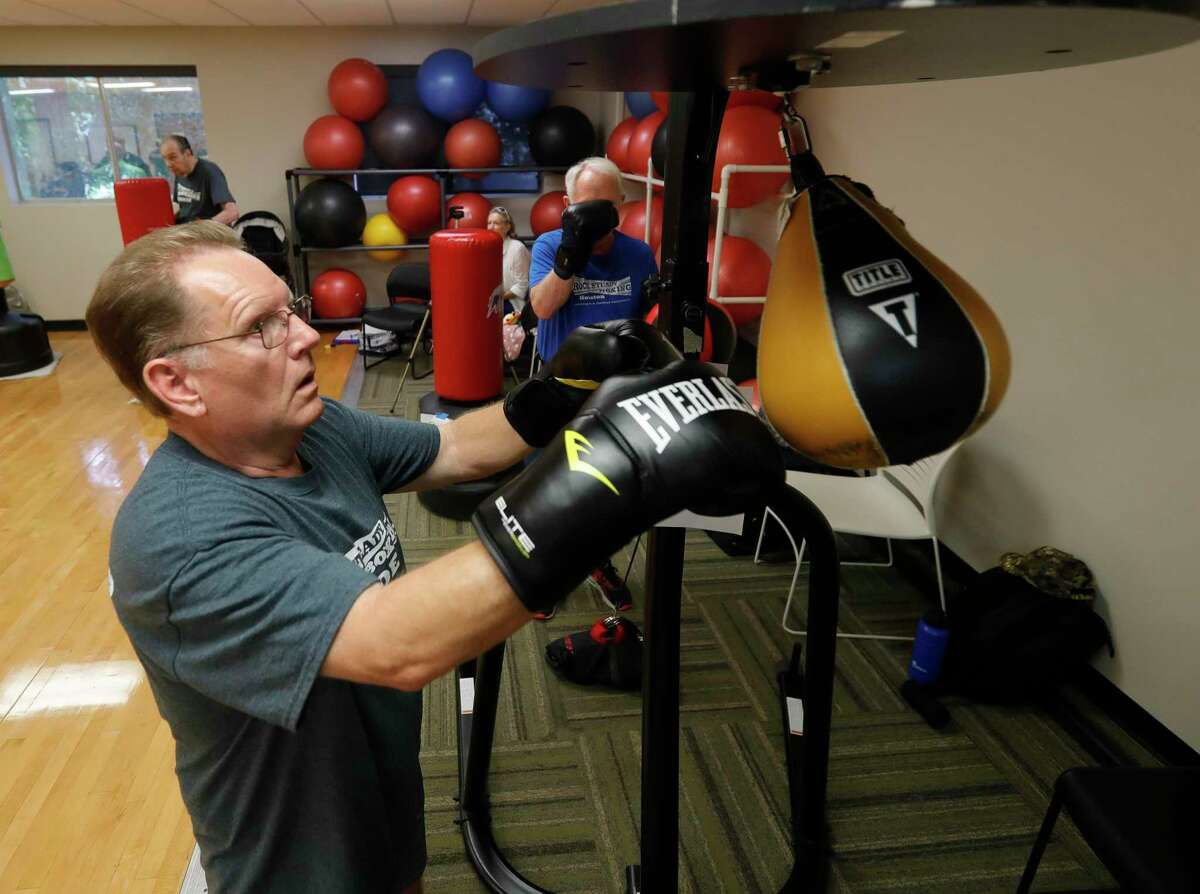 David Berryhill punches a speed bag during Rock Steady Boxing at the C.K. Ray Recreation Center, Friday, July 2, 2021, in Conroe. The weekly workout uses the basic functions of boxing to help residents with Parkinson disease strengthen areas of the brain affected by the disease such as balance, motor skills, and basic functions.