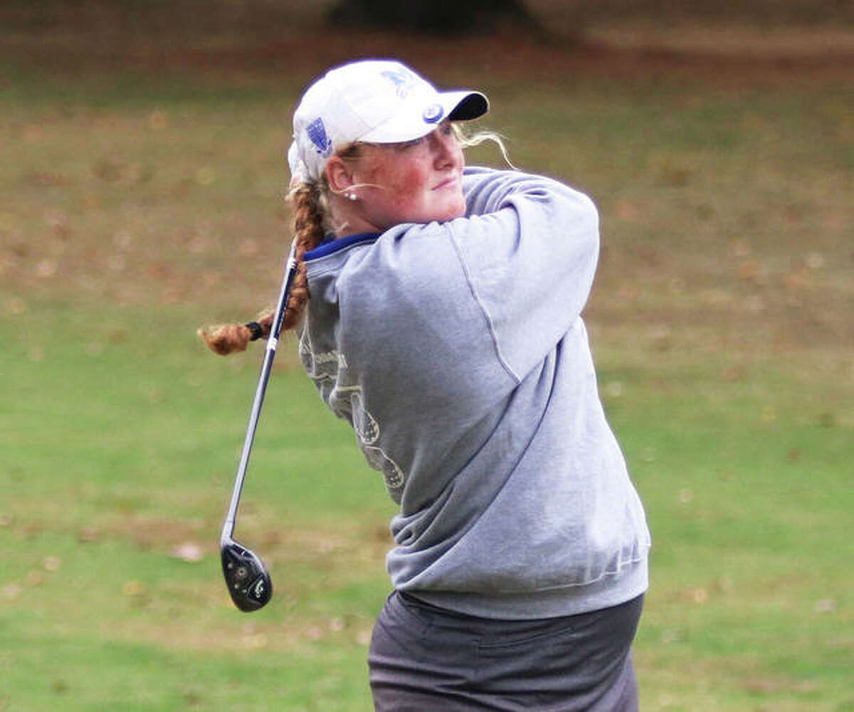 Marquette's Gracie Piar watches her shot toward the green during the Salem Class 1A Sectional last October in Salem. Piar shot 1-under par 72 to place second in the sectional.