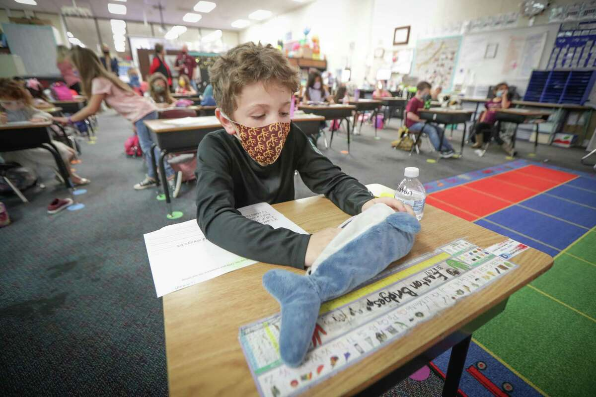 First grader Easton Bridges works on a assignment in his first grade class at Deer Park Elementary School March 30, 2021, in Deer Park.