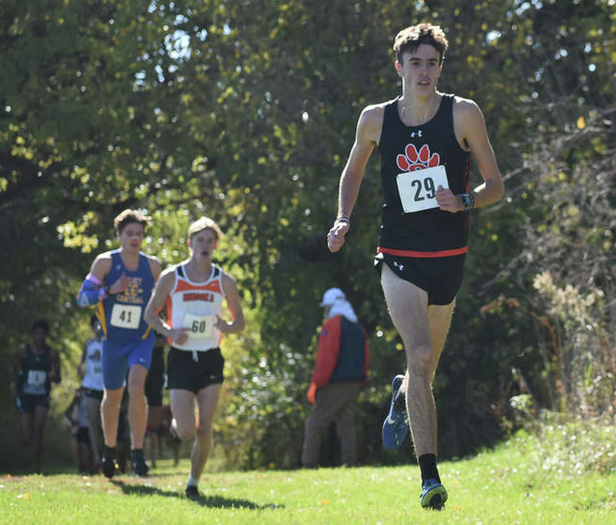 Edwardsville's Ryan Watts jogs ahead of a group of runners during the Class 3A Normal Community Sectional.