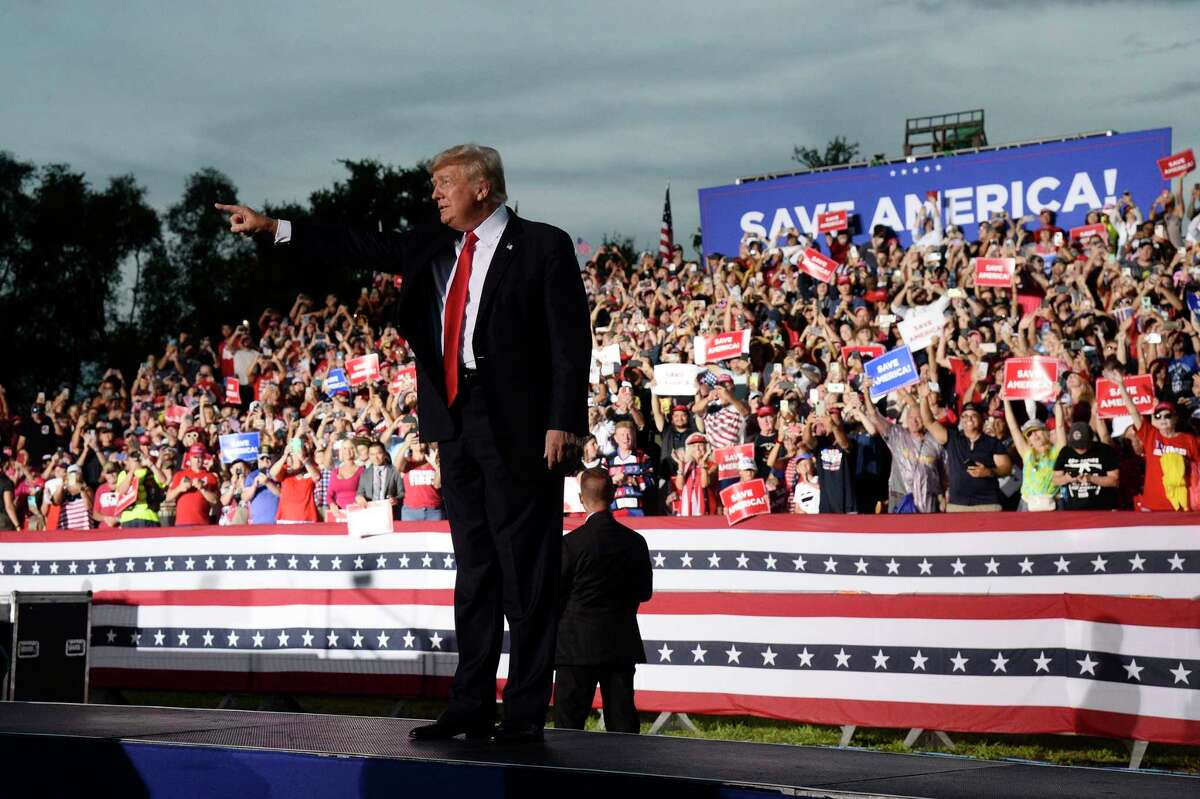 Former President Donald Trump walks on stage during a rally at the Sarasota Fairgrounds Saturday, July 3, 2021, in Sarasota, Fla.