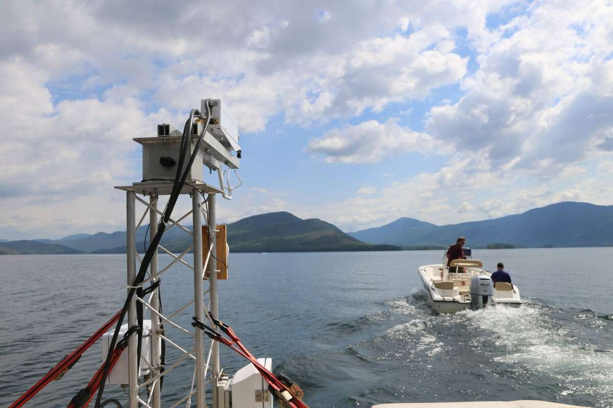 Part of a flux measurement system sits on the end of a pontoon boat for testing on Lake George. (Gwendolyn Craig/Adirondack Explorer)