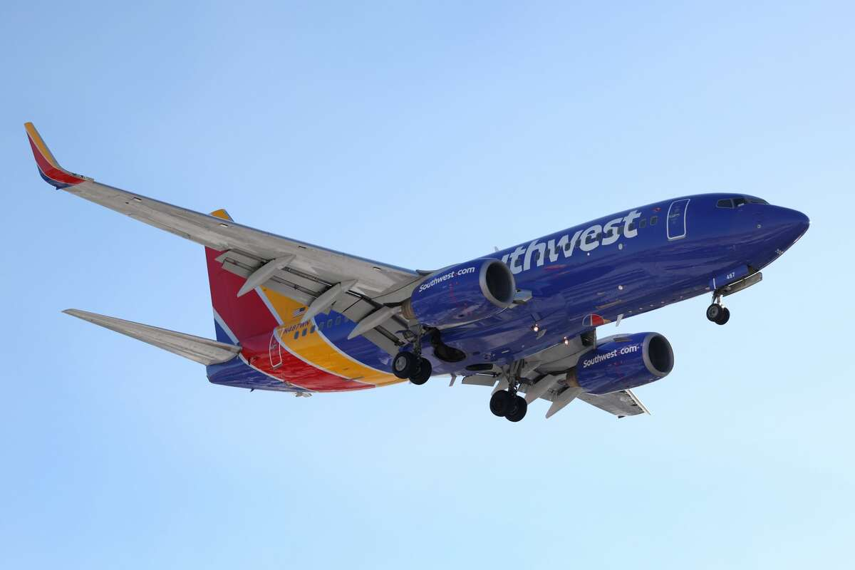CHICAGO, ILLINOIS - JANUARY 28: A Southwest Airlines jet lands at Midway International Airport on January 28, 2021 in Chicago, Illinois.(Photo by Scott Olson/Getty Images)
