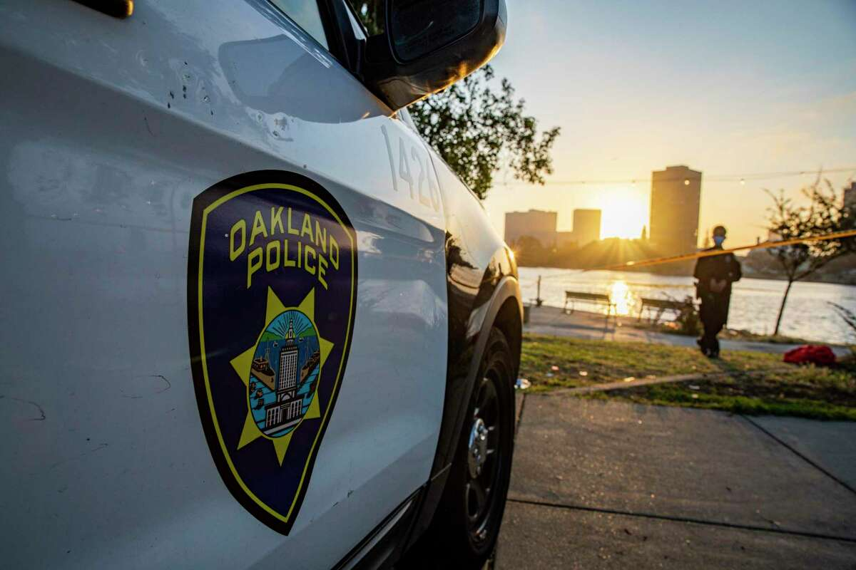 An Oakland police car near Lake Merritt. A 35-year-old man was killed in a shooting near a homeless camp early Tuesday morning in Oakland, police said.