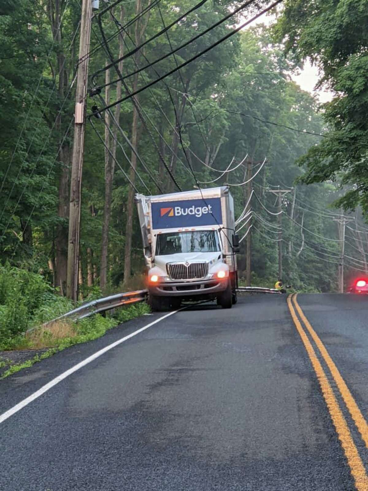 Route 111 through Monroe, Conn., is closed at East Village Road on Wednesday, July 7, 2021, after a vehicle collided with a pole.