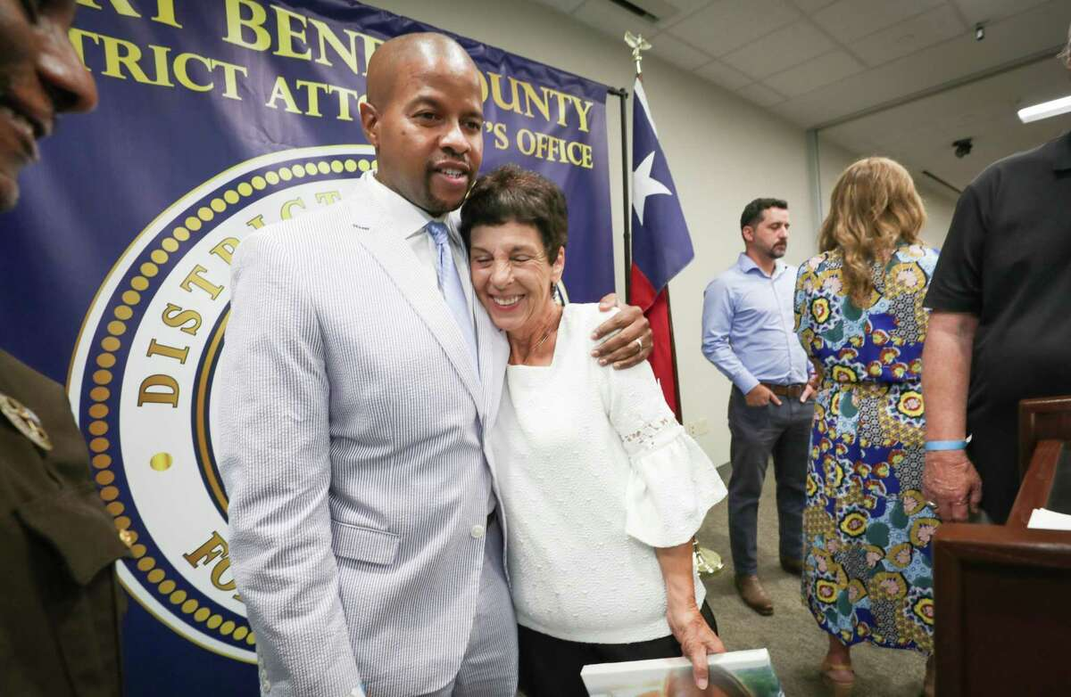 State Representative Ron Reynolds hugs Elaine Brooks, mother of Lisa Torry Smith after a press conference to announce the passage of a bill creating criminal penalties for striking and killing a pedestrian in a crosswalk Tuesday, July 6, 2021, in Richmond.