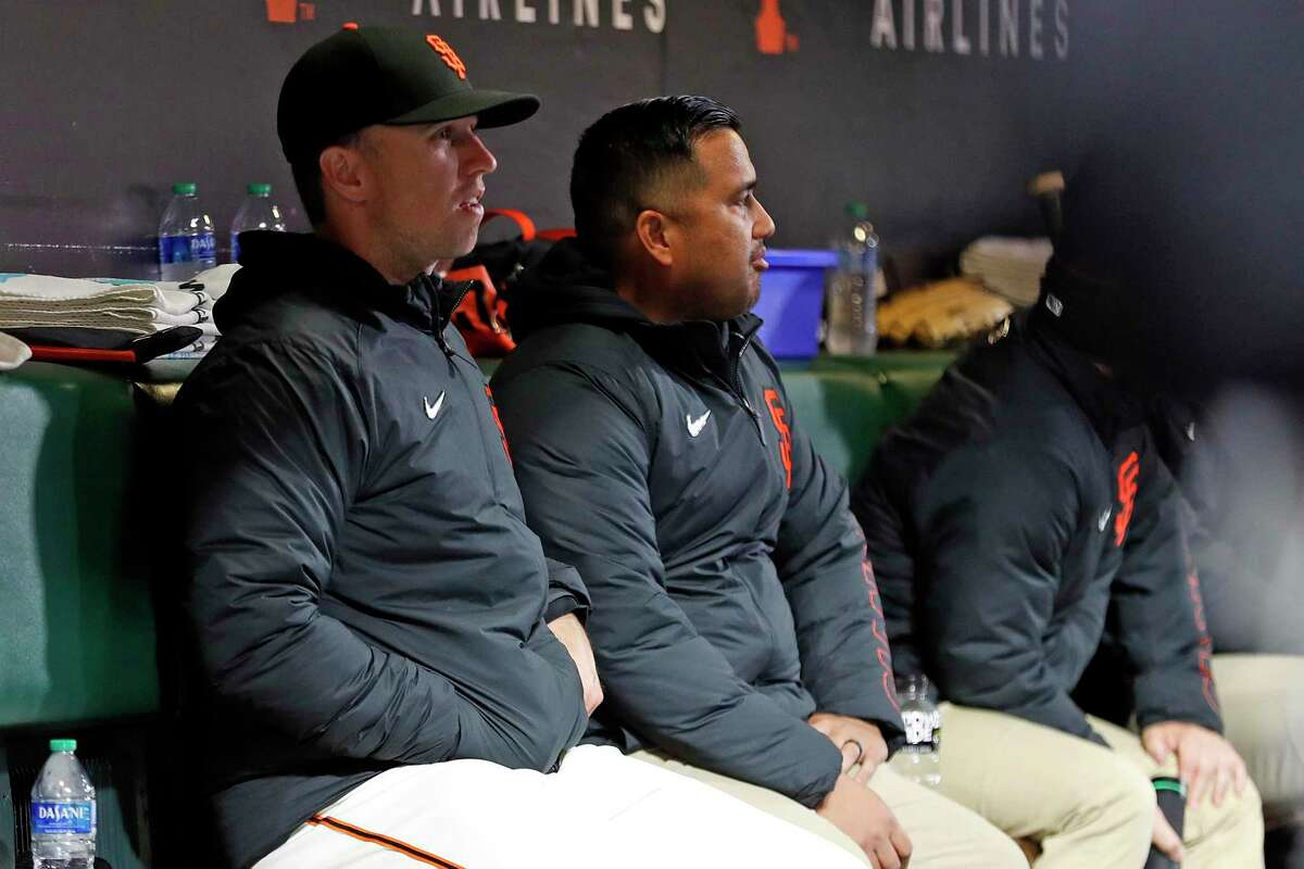 San Francisco Giants' Buster Posey watches from bench as Giants play St. Louis Cardinals during MLB game at Oracle Park in San Francisco, Calif., on Tuesday, July 6, 2021.
