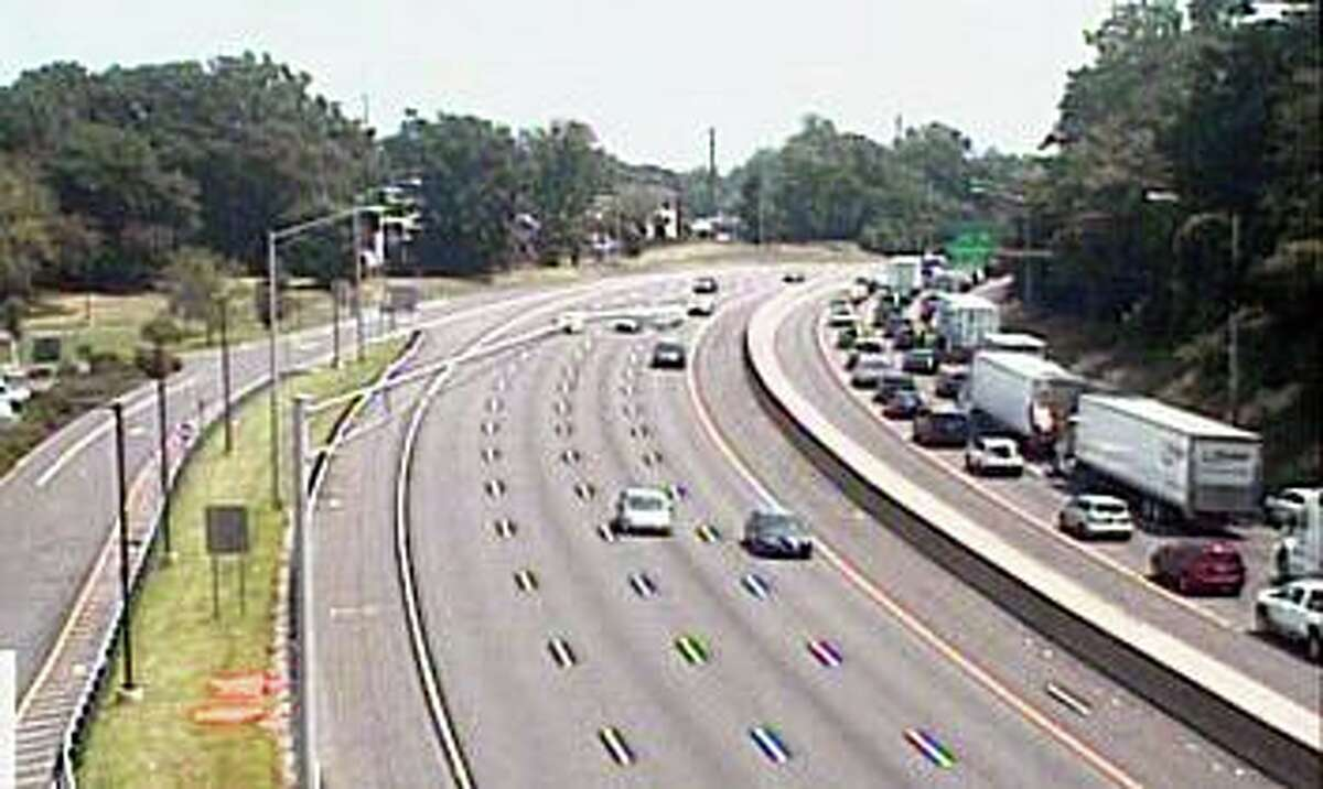 Traffic backed up on I-95 through Darien, Conn., after a two-vehicle crash on Wednesday, July 7, 2021.