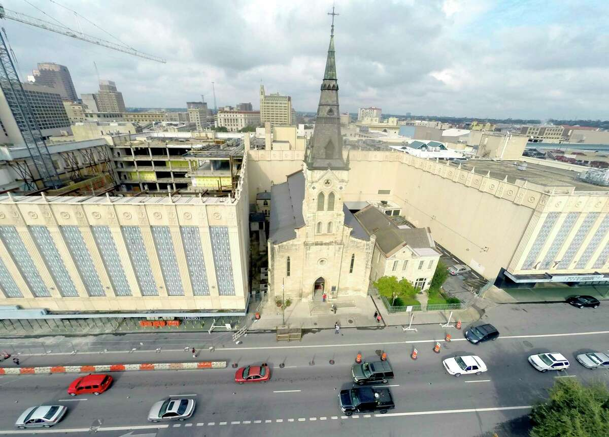 St. Joseph Catholic Church in downtown San Antonio, as seen in 2015. The former Joske's building can be seen at left and Rivercenter Mall, now known as the Shops at Rivercenter, is at the right of the church.
