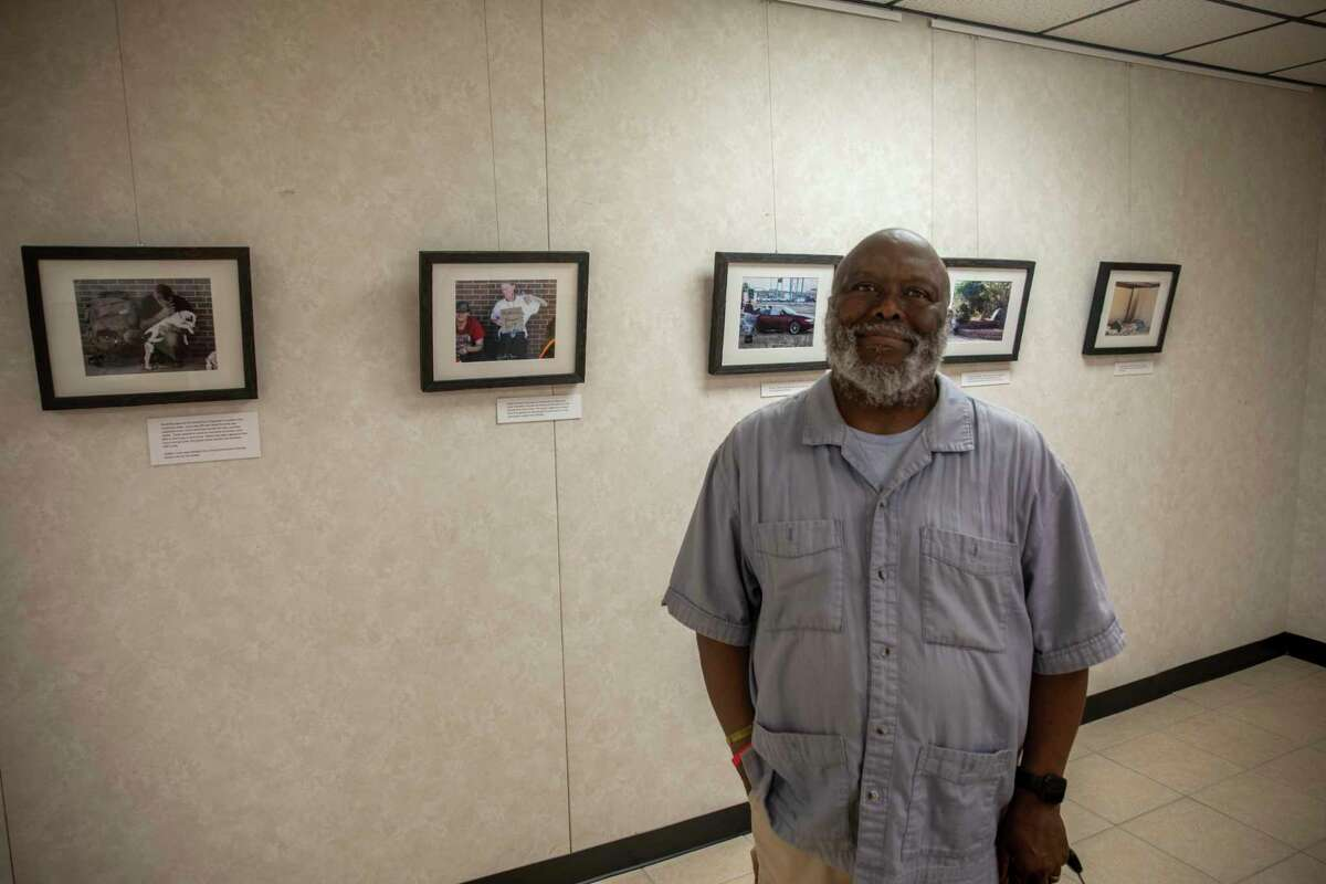 Conrad Coleman poses for a portrait with his exhibit ???Life on the Streets: Homeless in Midland, Texas??? on Thursday, July 1, 2021 at Sibley Nature Center. Jacy Lewis/Reporter-Telegram
