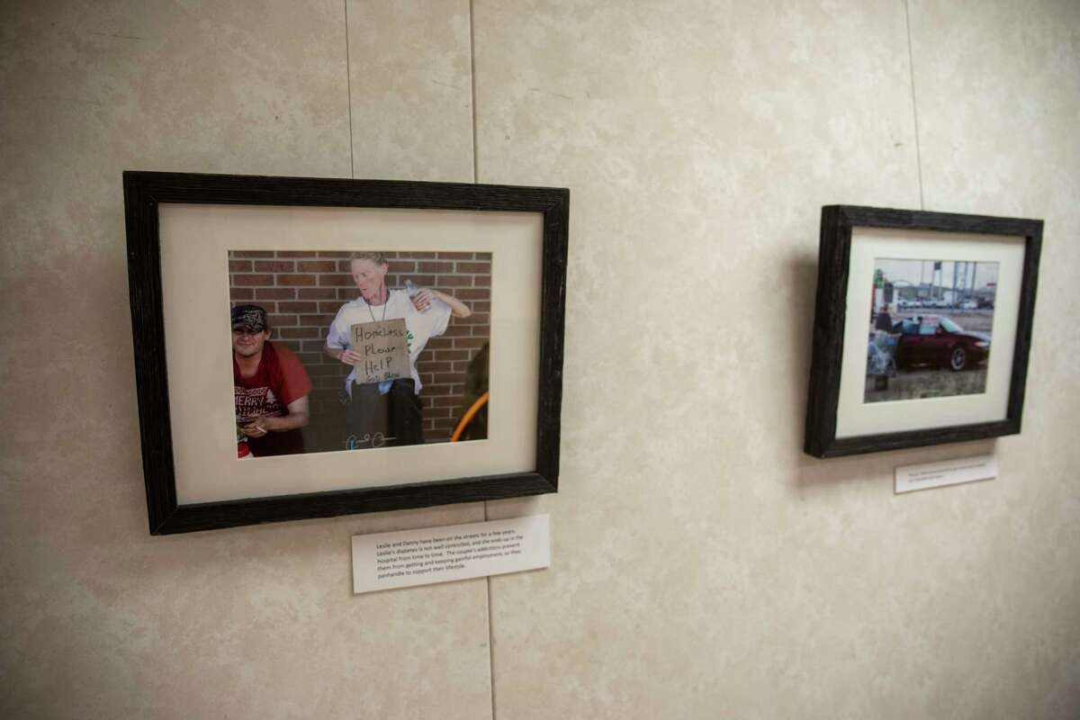 """Conrad Coleman poses for a portrait with his exhibit """"Life on the Streets: Homeless in Midland, Texas"""" on Thursday, July 1, 2021 at Sibley Nature Center. Jacy Lewis/Reporter-Telegram"""