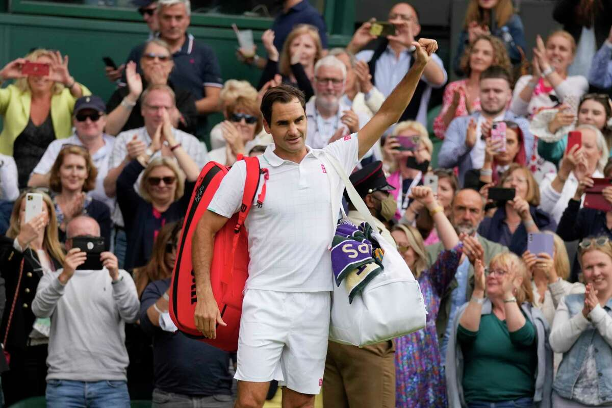 Switzerland's Roger Federer leaves the court after being defeated by Poland's Hubert Hurkacz during the men's singles quarterfinals match on day nine of the Wimbledon Tennis Championships in London, Wednesday, July 7, 2021.
