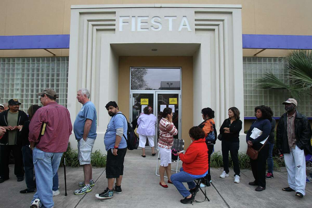 People wait in line to get tickets to Fiesta events at the Fiesta Store on Broadway in 2014.