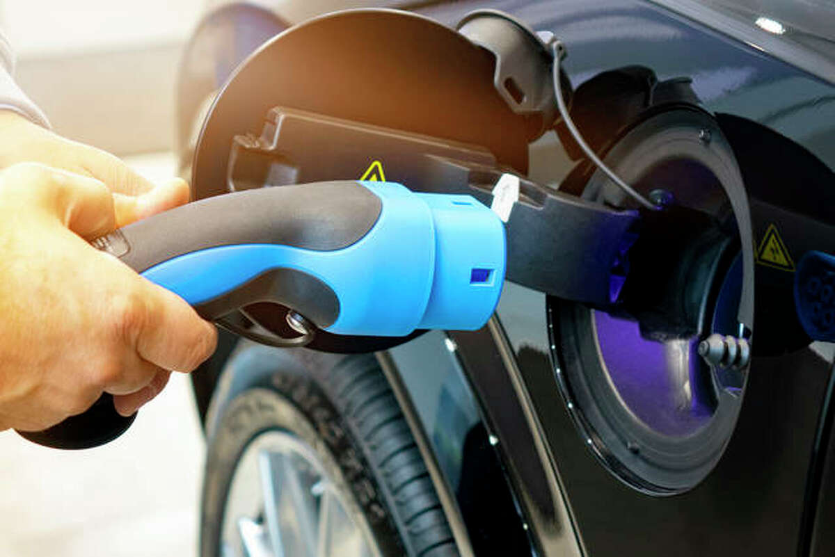 FILE - Electric Vehicle is charged