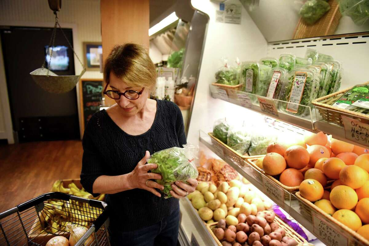 Pam Abrams shops for groceries at Four Seasons Natural Foods in Saratoga Springs. (Will Waldron/Times Union)