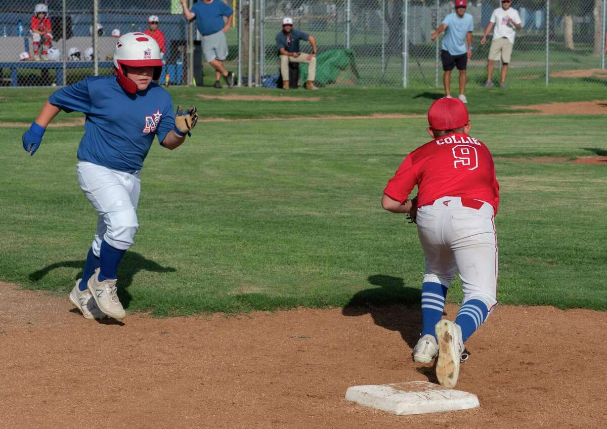 Case Collie, with 10 and under Northern All-Stars, gets the out at first as Charlie LaFerrell, with 11 and under Northern All-Stars runs on a hit 07/06/2021 as the two teams who qualified for the State tournament scrimmage each other at Butler Park. Tim Fischer/Reporter-Telegram