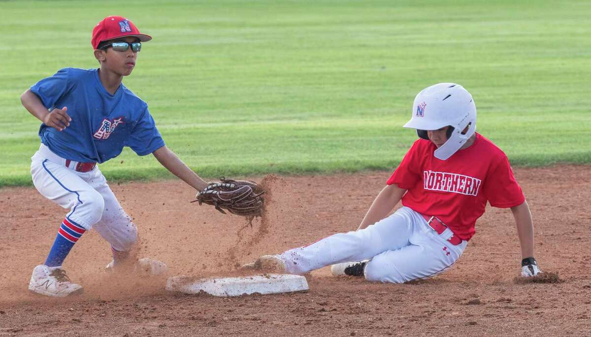 Isaac Solis, with 10 and under Northern All-Stars, safely steals second as Rohan Bhakta, with 11 and under Northern All-Stars, is late with a tag 07/06/2021 as the two teams who qualified for the State tournament scrimmage each other at Butler Park. Tim Fischer/Reporter-Telegram