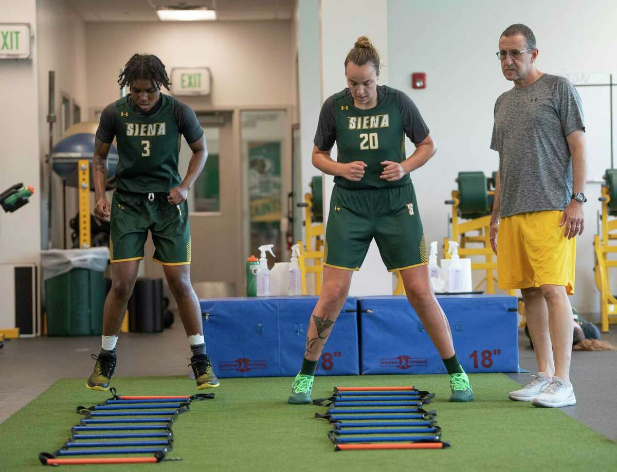 Head coach Jim Jabir, right, watches as Rayshel Brown, left, and Margo Peterson do a drill as Siena women's basketball holds summer workouts at Siena College on Wednesday, July 7, 2021, in Loudonville, N.Y. (Lori Van Buren/Times Union)