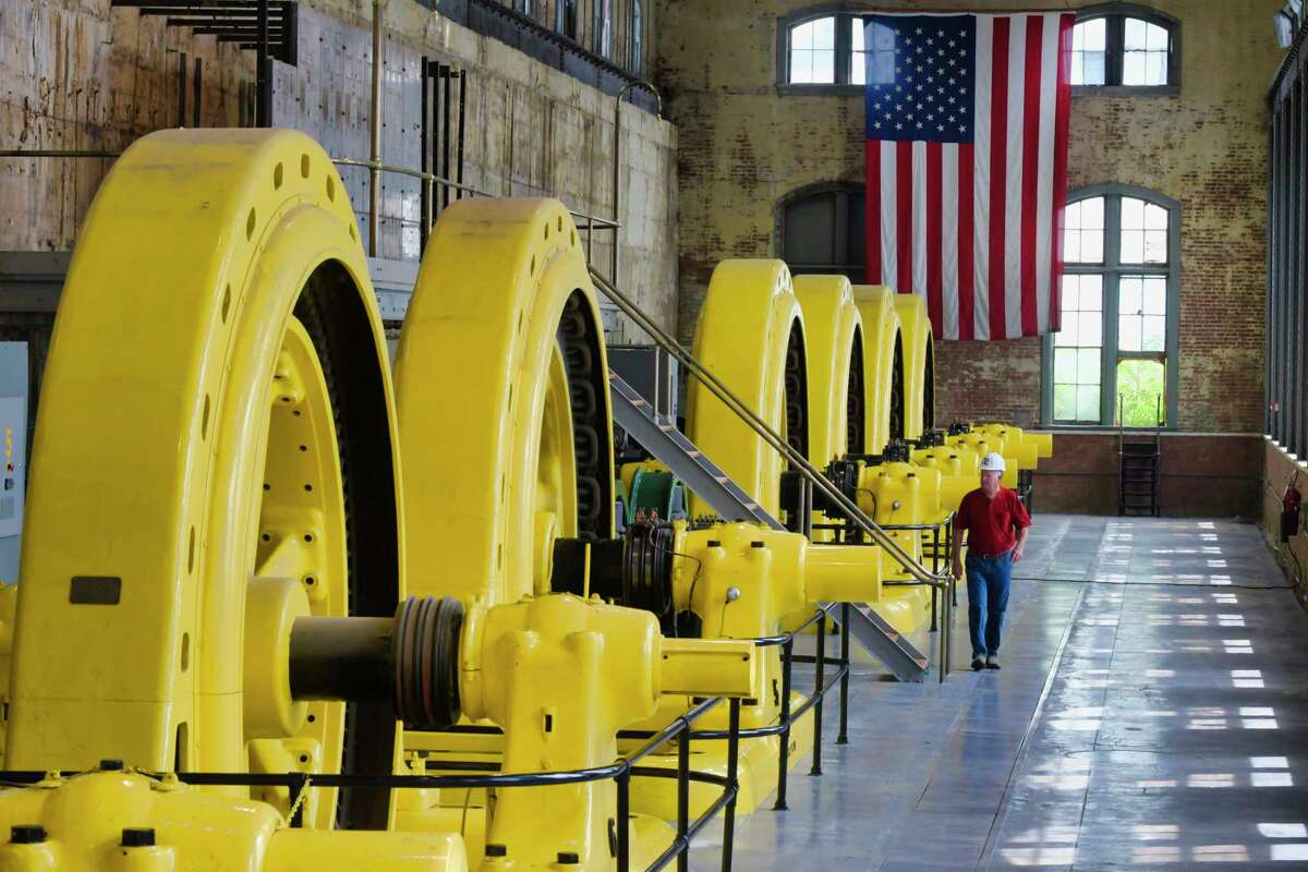 Jim Besha Sr., CEO of Albany Engineering Corporation, on the generator hall at the historic Mechanicville hydroelectric station on Wednesday, July 7, 2021, in Mechanicville, N.Y. The station is the oldest continuously operated hydroelectric station in the U.S. (Paul Buckowski/Times Union)